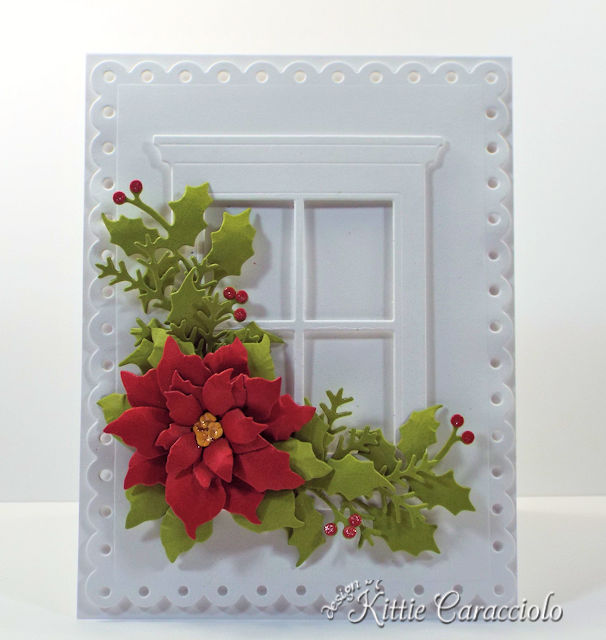 Come see how I made this festive die cut window and poinsettia card.