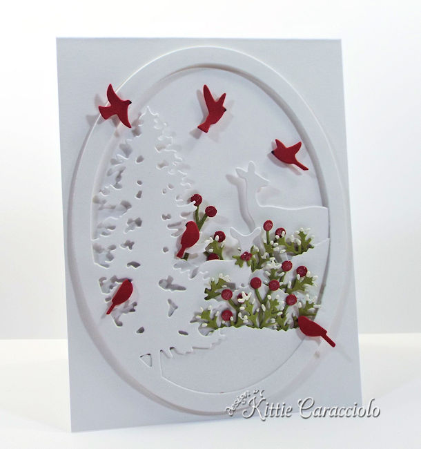 Come see how I made this lovely white on white die cut deer and pine scene.