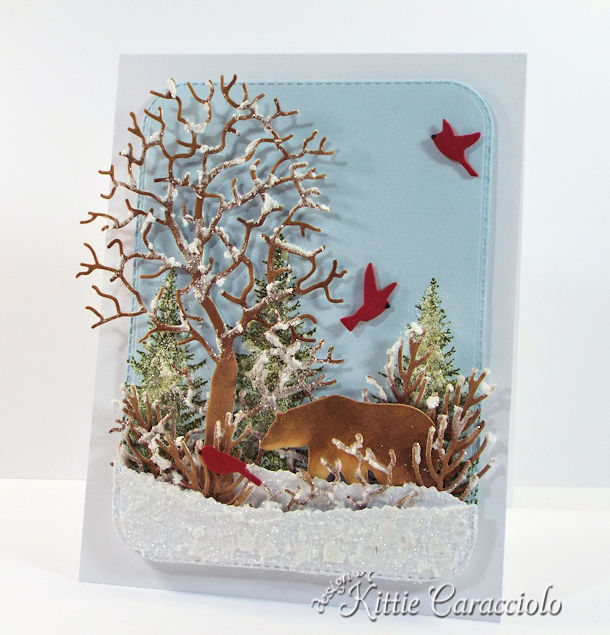 Come see how I made this masculine snowy die cut wildlife scene.