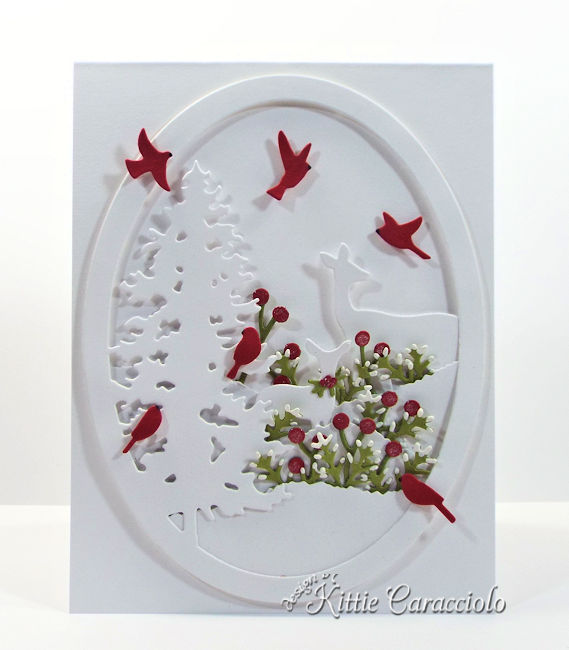 Come see how I made this pretty white on white die cut deer and pine scene.