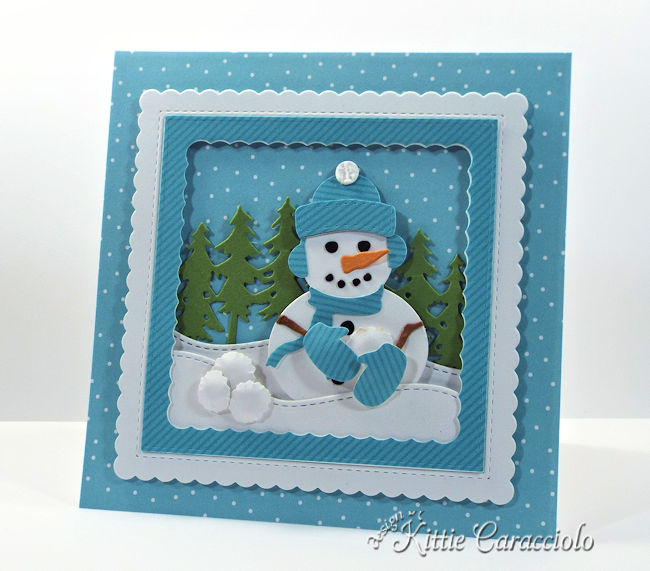 Come see how I made this snowman snowball fight scene using dies by Rubbernecker Stamps.