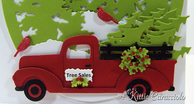 Come see how I made this snowy die cut christmas truck and trees card.