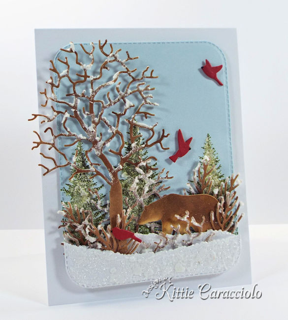 Come see how I made this snowy die cut wildlife scene with a bear.