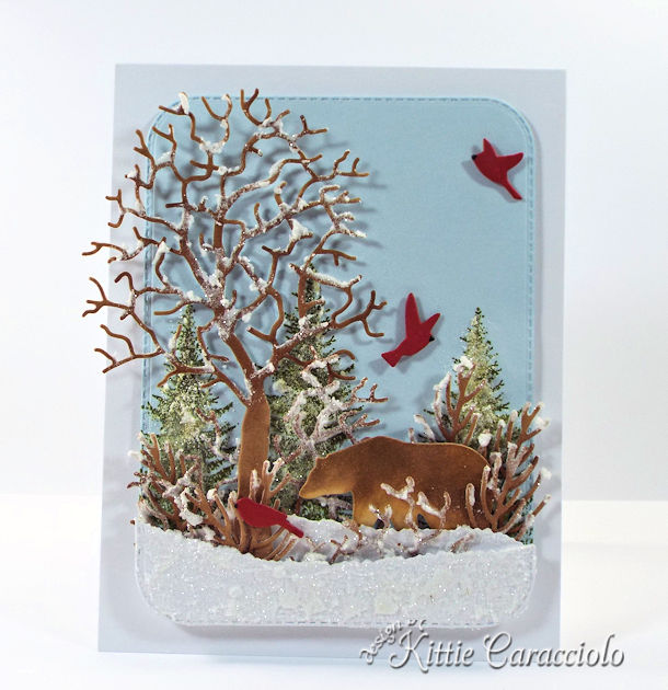 Come see how I made this snowy die cut wildlife scene.