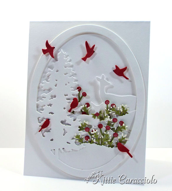 Come see how I made this white on white die cut deer and pine scene.