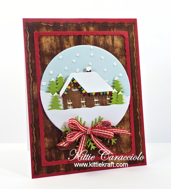 Come see how I made this Christmas snow globe cabin scene.
