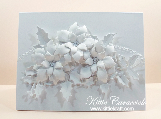 Come see how I made this elegant white on white poinsettias and holly card.