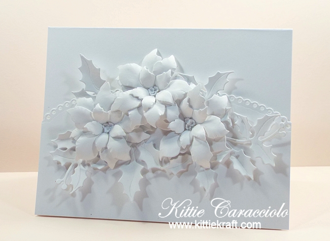 Come see how I made this lovely white on white poinsettias and holly card.