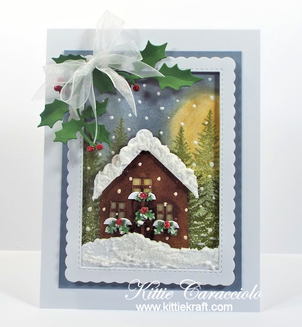 Come see how I made this snowy die cut Christmas cabin scene card.