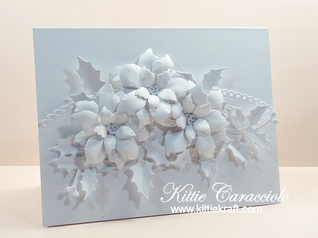 Come see how I made this white on white poinsettias and holly card.