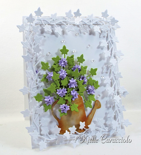 Check out how I made this foliage framed die cut watering can and flowers.