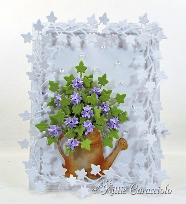 Check out how I made this ivy framed die cut watering can and flowers.