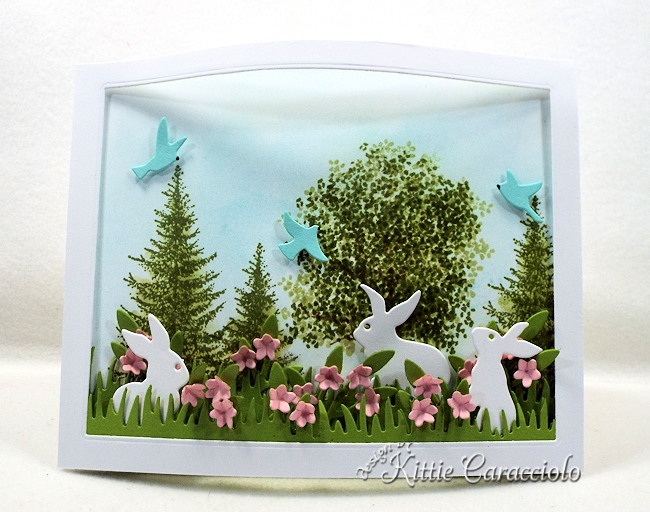 Come over to see how I made this colorful die cut bunnies and bendi frame scene.