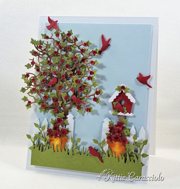 Come see how I made this cheerful die cut tree and birdhouse scene.