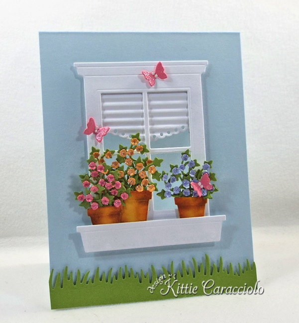 Come see how I made this pretty clean and simple die cut window and flower pots card.