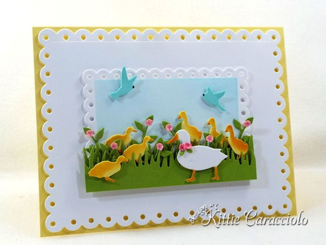Come see how I made this colorful die cut duck scene.