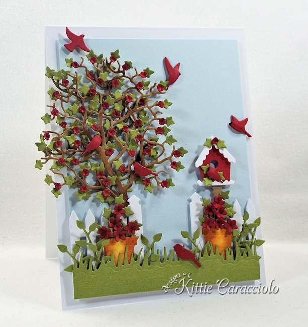 Come see how I made this colorful die cut tree and birdhouse scene.
