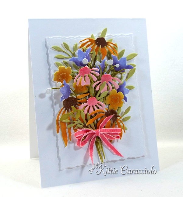 Come see how I made this colorful die cut wildflower bouquet.