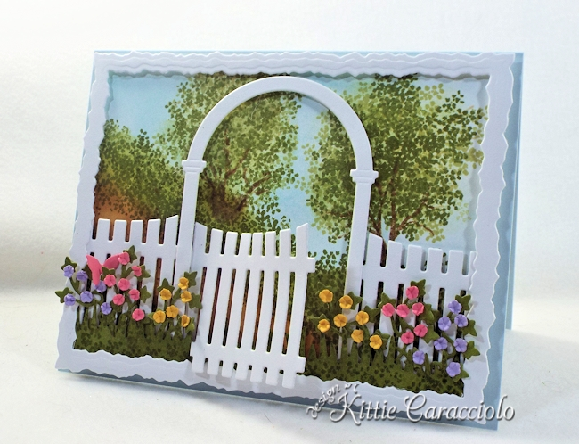 Come see how I made this die cut arbor garden scene.