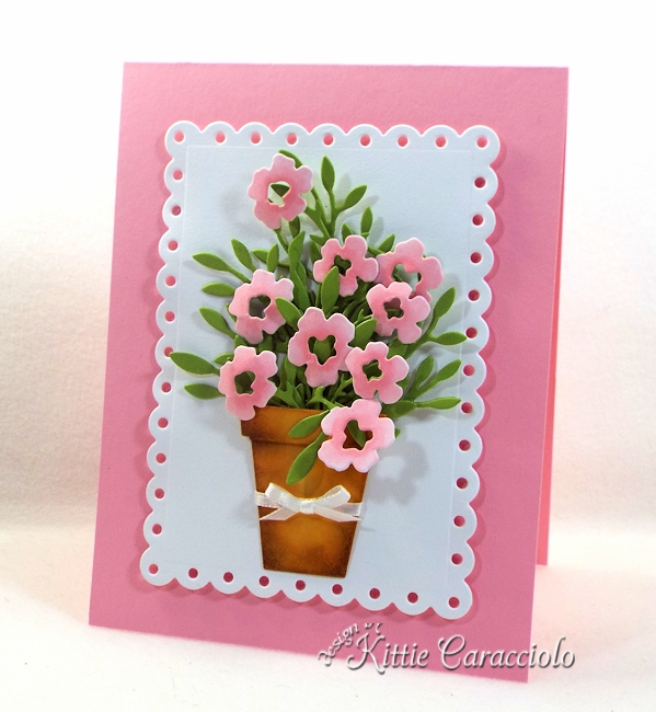 Come see how I made this die cut pot of flowers.