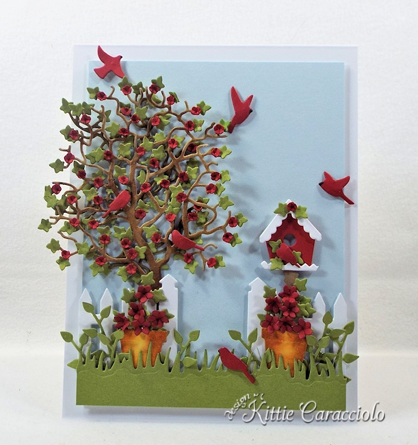 Come see how I made this die cut tree and birdhouse scene.