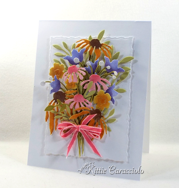 Come see how I made this die cut wildflower bouquet.