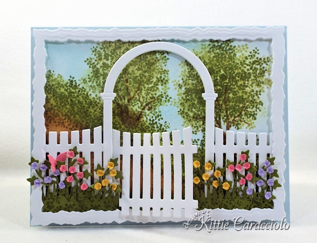 Come see how I made this pretty die cut arbor garden scene.