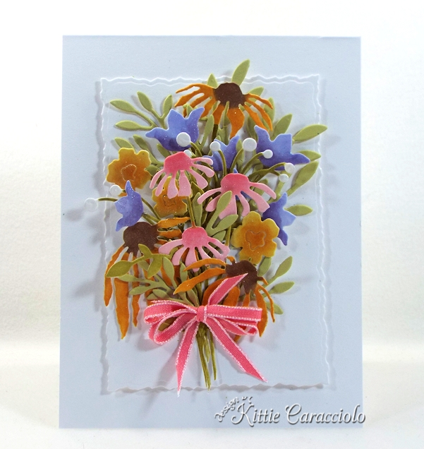 Come see how I made this pretty die cut wildflower bouquet.