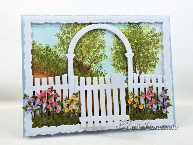 Come see how I made this spring die cut arbor garden scene.