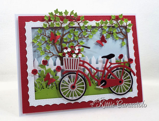 Come see how I made this colorful die cut bicycle scene.