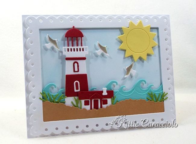 Come see how I made this framed die cut lighthouse scene.