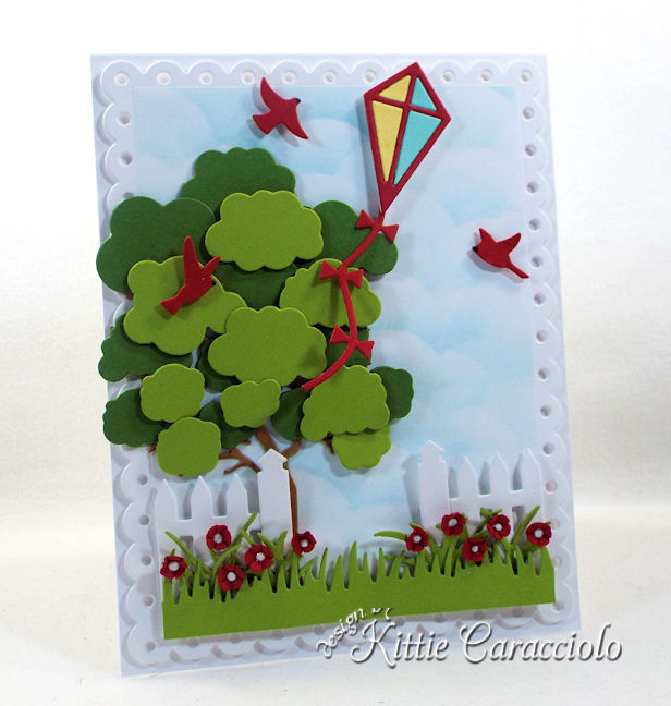 Come see how I made this cheerful die cut kite scene card.