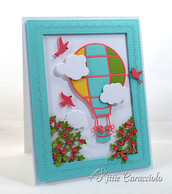 Come see how I made this colorful die cut hot air balloon scene card.