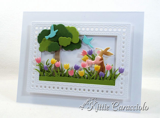 Come see how I made this colorful die cut spring bunny scene card.