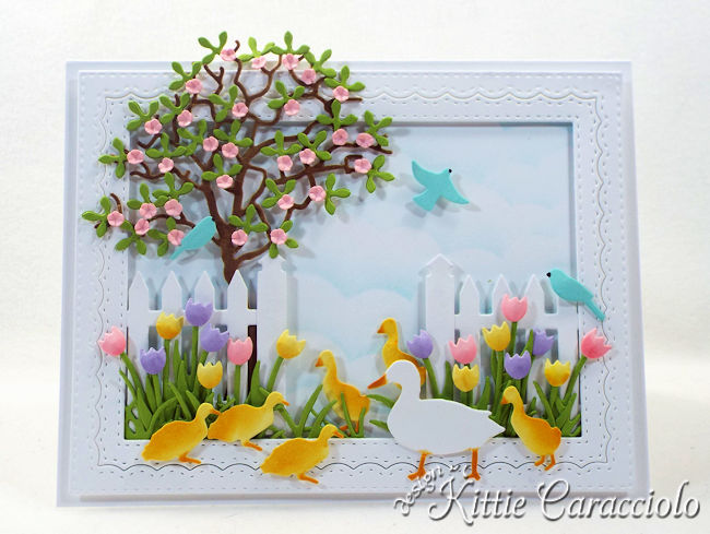 Come see how I made this colorful die cut spring duck scene.
