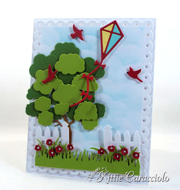 Come see how I made this die cut kite scene card.