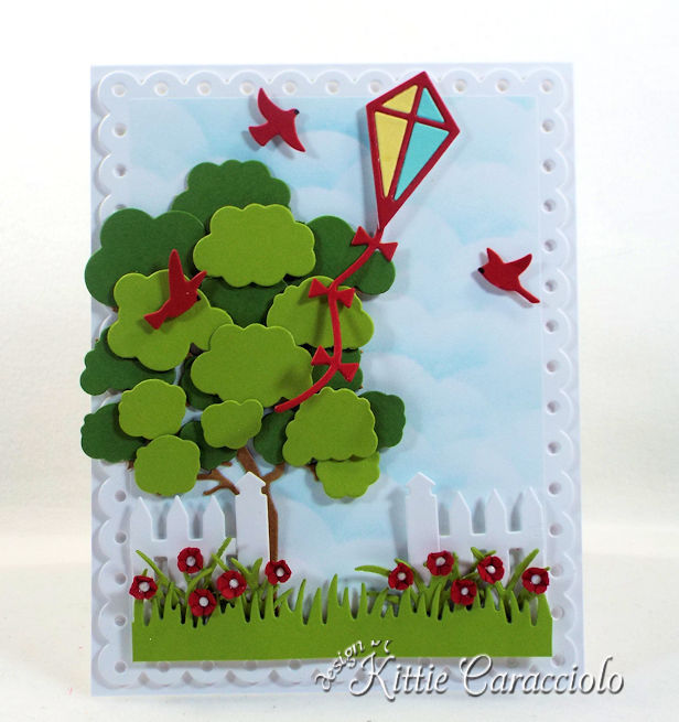 Come see how I made this fun die cut kite scene card.