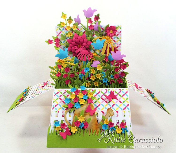Come check out how I made this colorful pop up flower garden box.