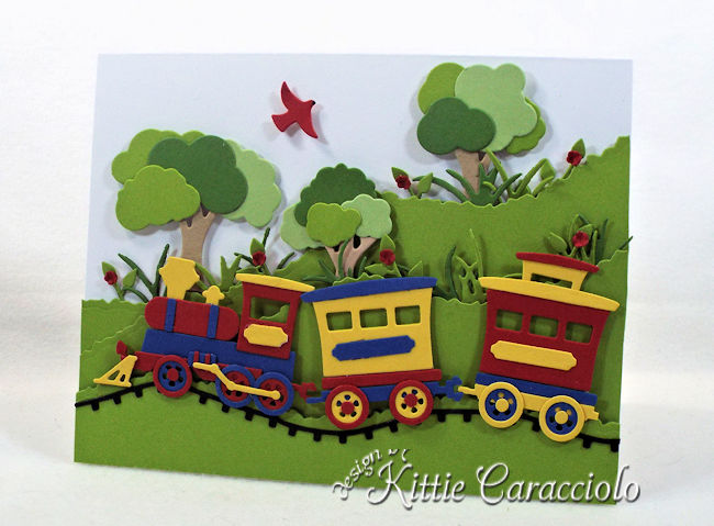 Come see how I made this colorful die cut train scene.