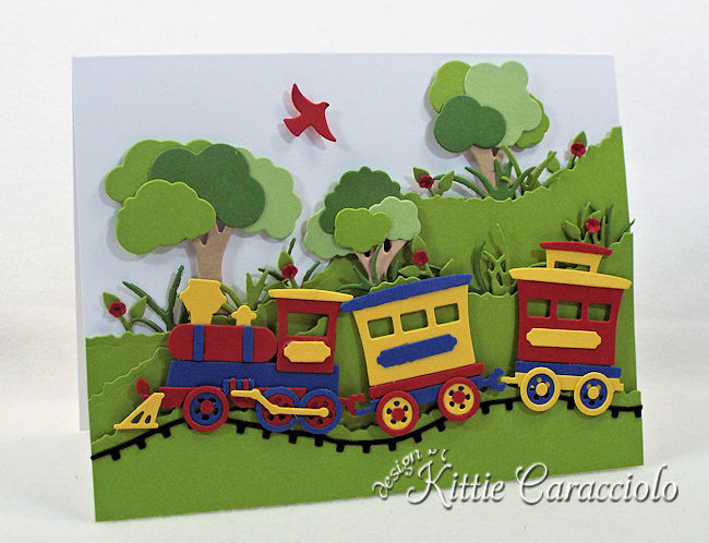 Come see how I made this cute die cut train scene.