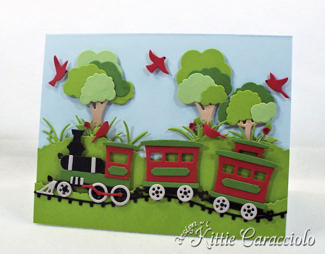 Come see how I made this die cut train scene.