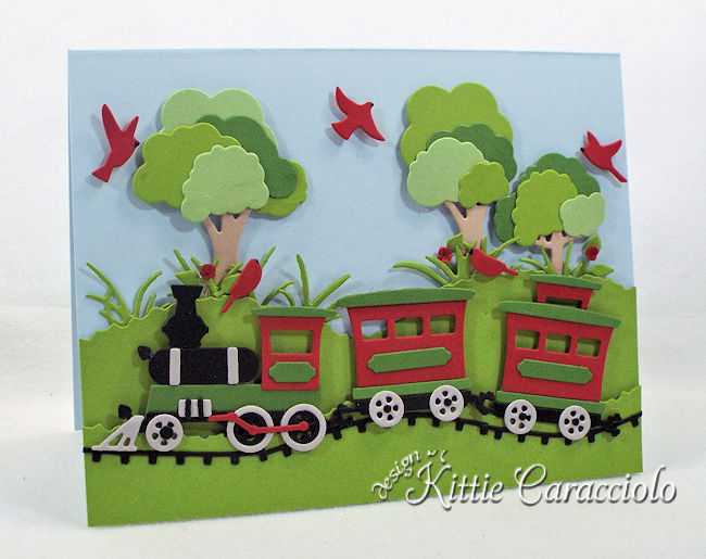 Come see how I made this fun die cut train scene.