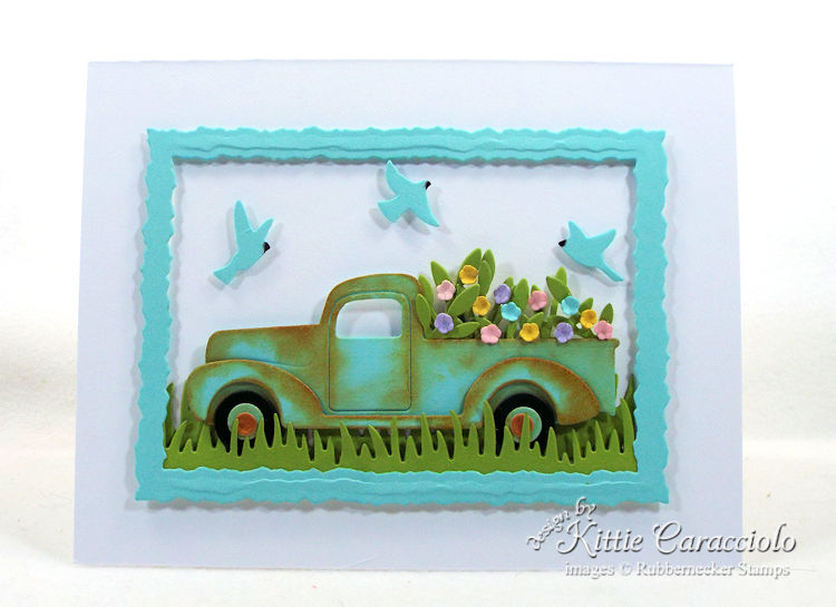 Come see my pretty framed die cut truck scene.
