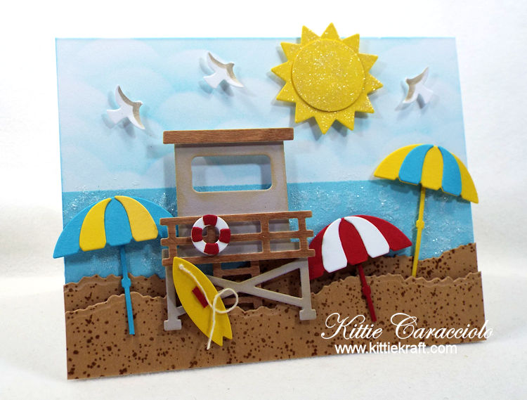 Come see how I made this fun umbrella beach scene card with die cuts.