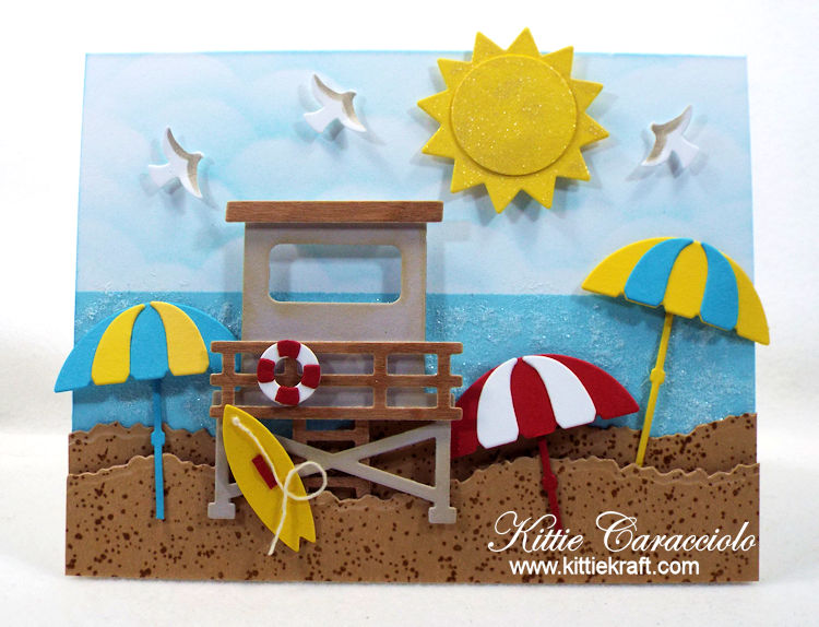 Come see how I made this sunny umbrella beach scene card with die cuts.