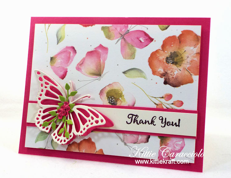 Come see how I made this clean and simple butterfly and watercolor flowers card.