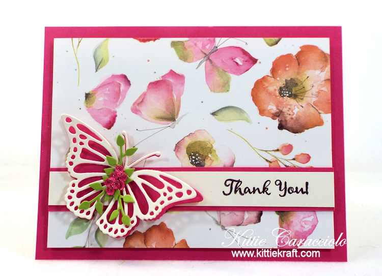 Come see how I made this pretty clean and simple butterfly and watercolor flowers card.