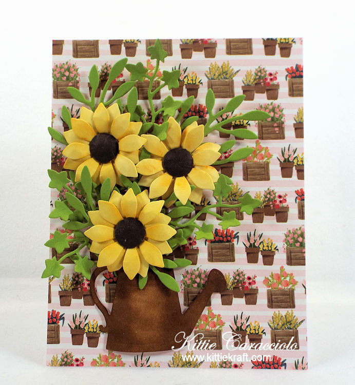 Come see how I made this watering can and flowers card.