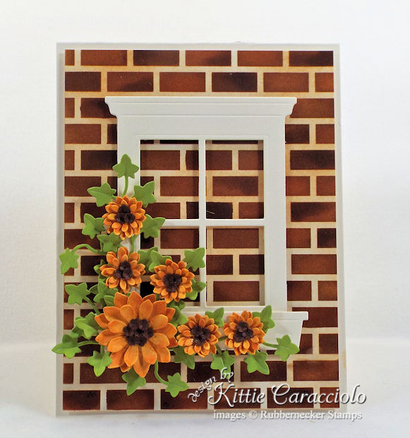 Come see how I made this floral window card with brick background.