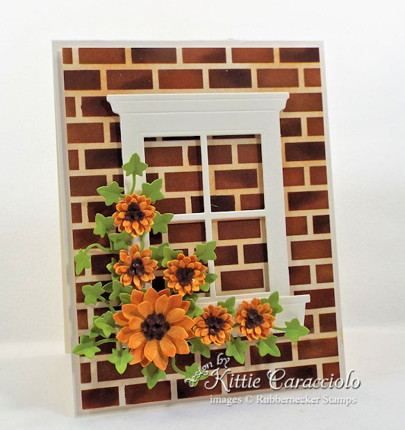 Come see how I made this sunflower window card with brick background.